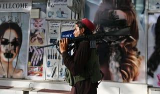 A Taliban fighter walks through central Kabul