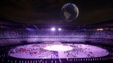 A drone display is seen over the top of the stadium during the Opening Ceremony