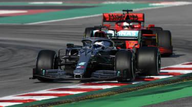 Mercedes driver Valtteri Bottas and Ferrari's Sebastian Vettel drive during pre-season testing