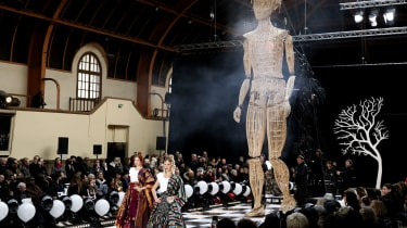 A model presents a creation by Frank Sorbier during the Haute Couture Spring-Summer 2014 collection show, on January 22, 2014 in Paris. AFP PHOTO / PATRICK KOVARIK(Photo credit should read PA