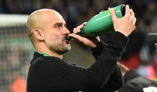 Man City manager Pep Guardiola drinks champagne as he celebrates the Carabao Cup win
