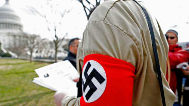 A member of the American Nazi Party outside Congress