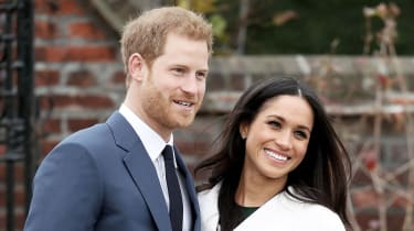Prince Harry and Meghan Markle pose at Kensington Palace