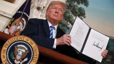 Donald Trump displays an executive order imposing economic sanctions on Iran