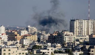 Smoke billows from Gaza City following Israeli military shelling