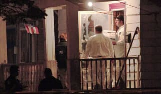 CLEVELAND, OH - MAY 7:FBI agents remove evidence from the house where three women who had disappeared as teenagers approximately ten years ago, were found alive on Monday May 7, 2013 in Cleve