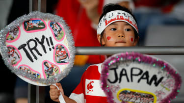 Japanese fans wait for their team to play in the Rugby World Cup's first match