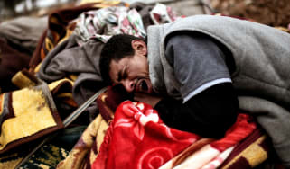 Relatives mourn as bodies of Iraqi residents of west Mosul killed in an airstrike targeting Islamic State (IS) group jihadist