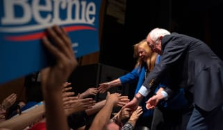 TOPSHOT - Democratic presidential hopeful Vermont Senator Bernie Sanders (R) and his wife Jane O'Meara Sanders shake hands with supporters after Sanders addressed a rally at the Abraham Chave