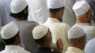 Muslim men praying