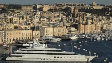 A superyacht in the Grand Harbour in Valletta, Malta