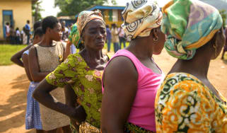 Women queue to vote outside a polling station in Ghana