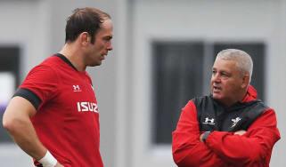 Wales captain Alun Wyn Jones speaks with head coach Warren Gatland