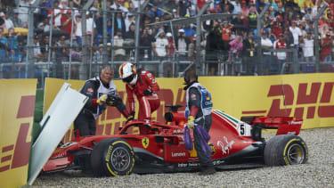 Sebastian Vettel climbs from his Ferrari after crashing out of the 2018 F1 German Grand Prix