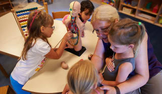 PFUNGSTADT, GERMANY - JULY 11:Kindergarten worker Marita Feigenspan explains to young children the human organs with a model in a Kindergarten (Kita) on July 11, 2013 in Pfungstadt, Germany.