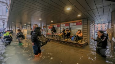 VENICE, ITALY - OCTOBER 29: Tourists await for the reopening of the Vaporetti service, after the authorities temporarily suspended it due to flooding caused by a high tide on October 29, 2018
