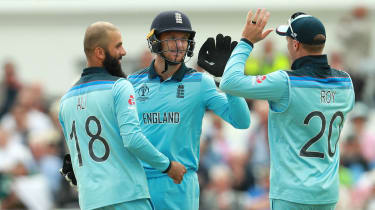 England wicketkeeper Jos Buttler celebrates a wicket with Moeen Ali and Jason Roy