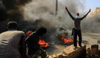 Protestors block a road in the Sudanese capital city Khartoum