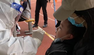 A child is tested for Covid-19 in Lanzhou, China