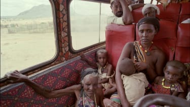 A family cross the Ethiopian border in 1992, having fled fighting in Ogaden