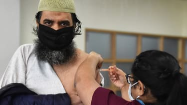 A man gets vaccinated at City Central Mosque in Stoke