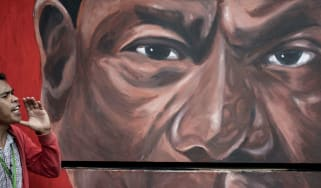 A mural of Rodrigo Duterte watches over a demonstration against drug war killings