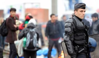 French police evict migrants from Calais camps