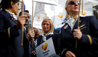 Ex-Thomas Cook employees demonstrate in London on October 2, 2019, after delivering a petition calling for a full inquiry into Thomas Cook's collapse and for the company's directors to pay ba