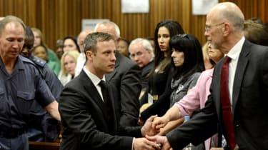 Oscar Pistorius hands his Uncle Arnold his watch after sentencing