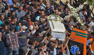 Mourners carry the coffin of one of seven Christians killed in Egypt on Friday