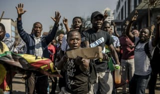 Supporters of  MDC Alliance take part in a protest in Harare at alleged election rigging