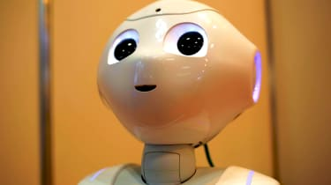 Pepper the robot talks to guests at Japan Robot Week 2016 in Tokyo