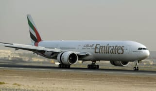An Emirates plane readies for take-off at Dubai airport