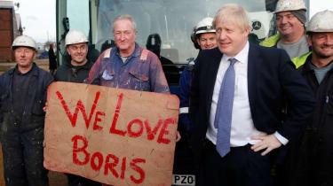 Boris Johnson poses with workers during a visit to Wilton Engineering Services