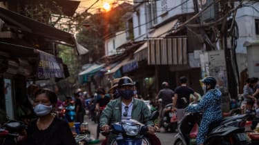 People wearing face masks to stop the spread of Covid in Hanoi, Vietnam
