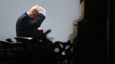 Boris Johnson walks back to 10 Downing Street from the Foreign and Commonwealth Office.