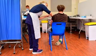Boy receiving Covid vaccine