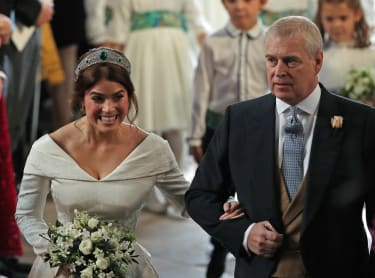 WINDSOR, ENGLAND - OCTOBER 12: Princess Eugenie of York arrives with her father Prince Andrew, Duke of York, ahead of her wedding to Mr. Jack Brooksbank at St. George's Chapel on October 12,