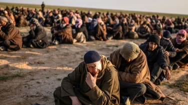 Suspected Isis fighters in Baghouz, Syria