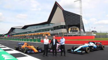 F1 chief Chase Carey (centre) with British Racing Drivers' Club chairman John Grant and Silverstone's Stuart Pringle