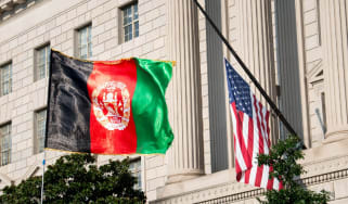 An Afghanistan flag is seen waving in front of a US flag on 28 August 2021 in Washington, DC