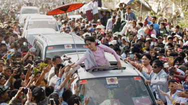 Aung San Suu Kyi greets supporters in 2015