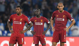 Liverpool's Georginio Wijnaldum, Sadio Mane and Fabinho react during the defeat against Napoli