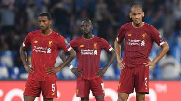 Liverpool's Georginio Wijnaldum, Sadio Mane and Fabinho react during the defeat against Napoli