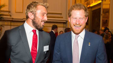 LONDON, UNITED KINGDOM - OCTOBER 12: England Rugby Union Captain Chris Robshaw (left) speaks with Prince Harry at a reception at Buckingham Palace on October 12, 2015 in London, United Kingdo