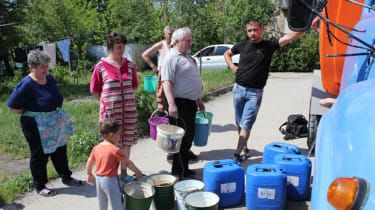 Local residents in Crimea lining up to get drinking water