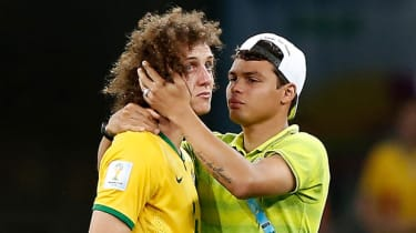 Thiago Silva comforts David Luiz after Brazil's 7-1 semi-final loss