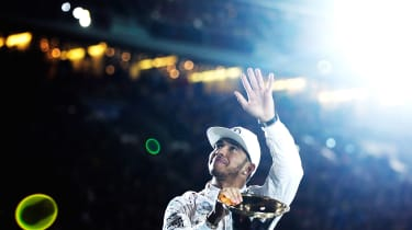 STUTTGART, GERMANY - DECEMBER 12: Lewis Hamilton of Great Britain and 2015 F1 World Champion waves to the crowd before the first round of races in the Mecedes-AMG A 45 of the Stars and Cars e