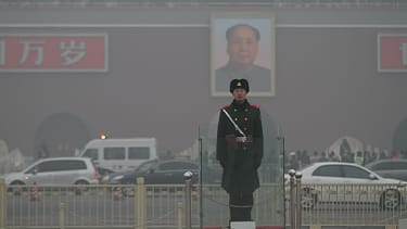 BEIJING, CHINA - JANUARY 16:(CHINA OUT) A Chinese policeman stands guard on the Tiananmen Square which is shrouded with heavy smog on January 16, 2014 in Beijing, China. Beijing Municipal Gov