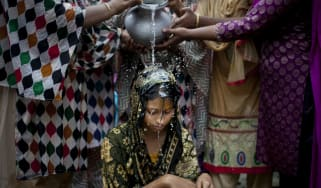 A 15-year-old girl prepares for her wedding in Bangladesh